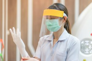 Dentist wearing PPE in their dental office during COVID-19