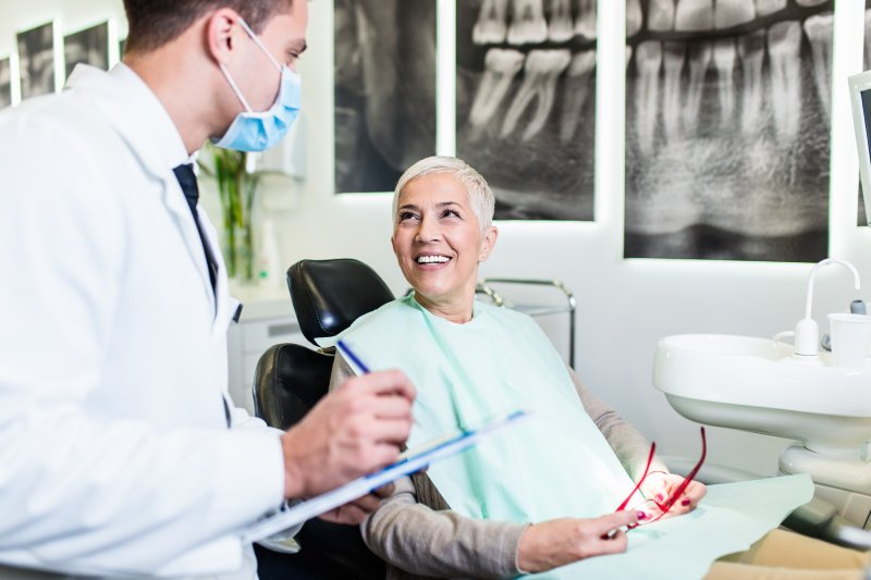 Dentist talking to patient about dental implant aftercare