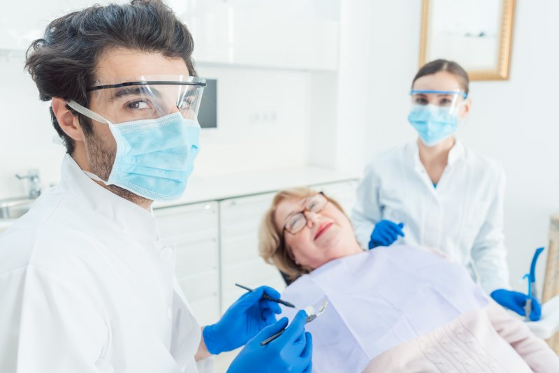 Dentist in Scripps Ranch wearing PPE at appointment